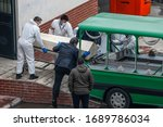 Funeral Vehicles Stand In Fron...
