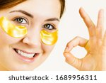 young woman applying mask... | Shutterstock . vector #1689956311