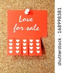 Red paper add with Love for sale text pinned to the corkboard - stock photo