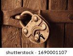Old Lock Hanging On Wooden Door....
