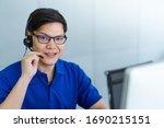 Call Center Man In Blue Shirt...