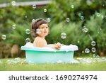 Happy Little Girl Floating In...