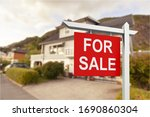 Real Estate Sign In Front Of...