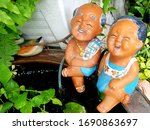 Statues Of Grandparents And...