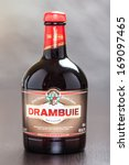 Small photo of ZAGREB, CROATIA - DECEMBER 27, 2013: Bottle of Drambuie, Scotland's sweet, golden coloured 40% ABV liqueur, a unique concoction of Scotch whisky, heather honey and herbs and spices.