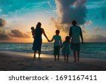 Happy Family With Kids Walk At...