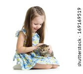 Stock photo kid playing with scottish kitten 169169519