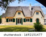 Thatched House In The French...