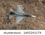 United States Air Force (USAF) F-16 Fighting Falcon from Edwards Air Force Base flying low level in Death Valley California