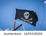 Pirate flag with blue sky skull ...