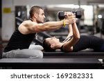 personal trainer helping woman... | Shutterstock . vector #169282331