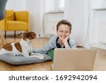 Young Boy Relaxing At Home With ...