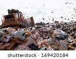 Truck Working In Landfill With...