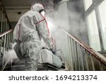 coronavirus pandemic, disinfection against COVID-19 virus. professional disinfector in protective clothing, suit fight with pandemic health risk, remove bacterias and infections use special equipments - stock photo