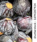 Small photo of Group of red cabbages in a supermarket, Cabbage background, Fresh cabbage from farm field, a lot of cabbage at market place. close-up of fresh white cabbage