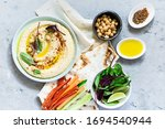 Classic Hummus In A Bowl With...