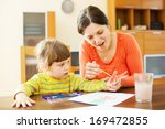 happy mother and baby  plays... | Shutterstock . vector #169472855
