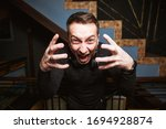 the face of a man with emotions.... | Shutterstock . vector #1694928874