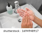 Washing Hands Rubbing Soap In...