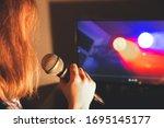 Girl Is Singing Karaoke At Home....