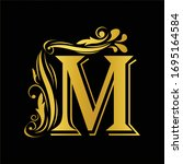 gold letter m. vintage golden...   Shutterstock .eps vector #1695164584