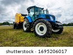 New Blue Tractor With Baler...