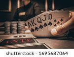 Small photo of Poker Hands / Royal Flush. Five playing cards - the poker royal flush hand. Royal Flash, card deck, poker royal flash on cards and poker chips on green casino table. success in gambling. soft focus