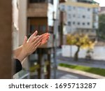 Small photo of Hands clapping in a balcony for coronavirus doctors and nurses who deserve a big applause. medical concept