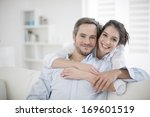 couple at home relaxing in sofa | Shutterstock . vector #169601519