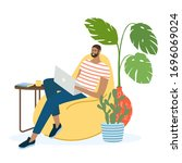 man sitting on sofa with laptop ... | Shutterstock .eps vector #1696069024
