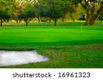 Golf Green And Sand Trap  With...