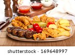 mixed grilled and fried  meat... | Shutterstock . vector #169648997