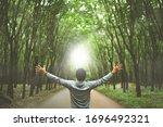 Man Raise Hand Up In Forrest...