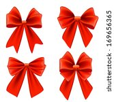 set of four textured red bows... | Shutterstock . vector #169656365