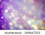 golden small hearts on purple... | Shutterstock . vector #169667321