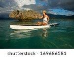 young beautiful girl surfer... | Shutterstock . vector #169686581