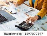 Woman accountant use calculator ...