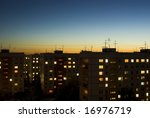 Dusk Sky And Houses With Lit...
