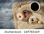 Donuts with coffee for a break - stock photo