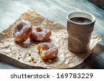 Closeup of hot coffee and donuts - stock photo