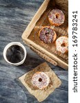 Hot coffee and fresh donuts - stock photo