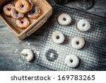 Tasting freshly baked donuts - stock photo