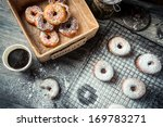 Tasting freshly baked donuts with coffee - stock photo
