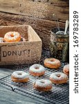 Closeup of falling powder sugar on fresh donuts - stock photo