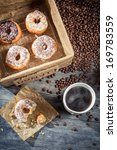Fresh donuts with coffee - stock photo