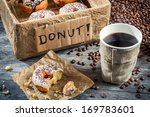 Fresh donuts with coffee for breakfast - stock photo