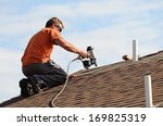 Building Contractor Putting Th...