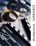 movie clapper and film reel on... | Shutterstock . vector #169841825