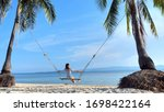 woman  on swing at tropical... | Shutterstock . vector #1698422164