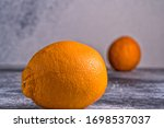 Small photo of Clop Fresh orange fruit on gray background.